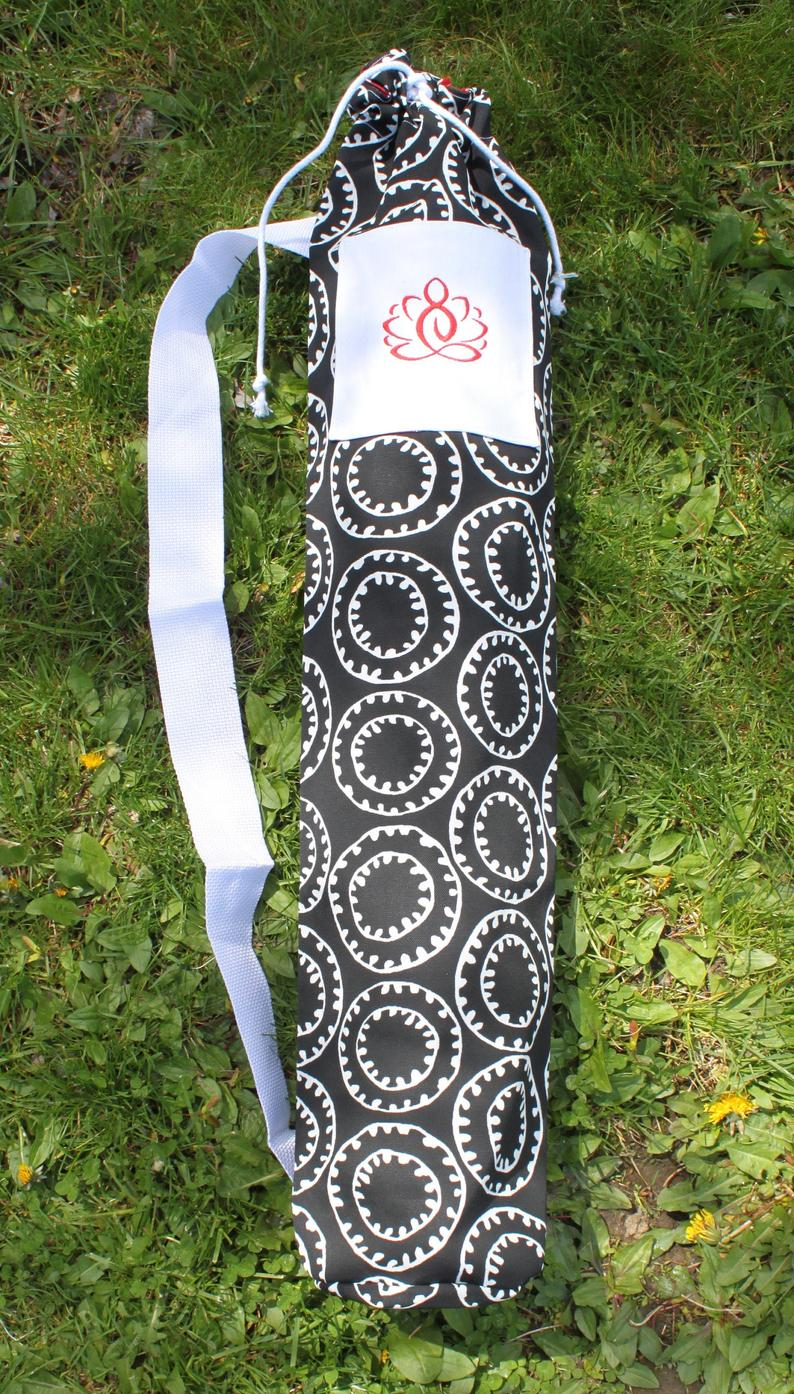 Sling-Style Yoga Mat Bag with Drawstring Close and Embroidered Front Pocket with Black & White Circular Print