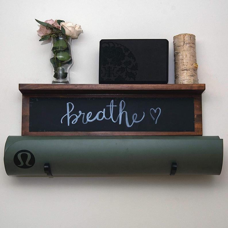 Chalkboard yoga mat holder with shelf.