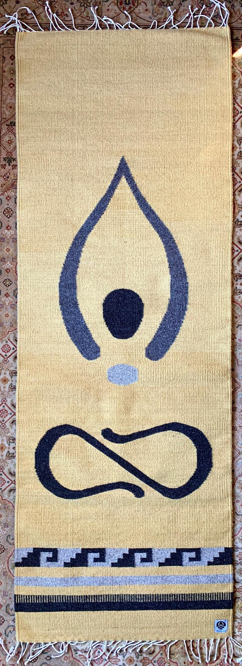 Handwoven, hand dyed wool mat.  May be used on top of your yoga mat, as a runner in your home, or as a beautiful wall hanging.