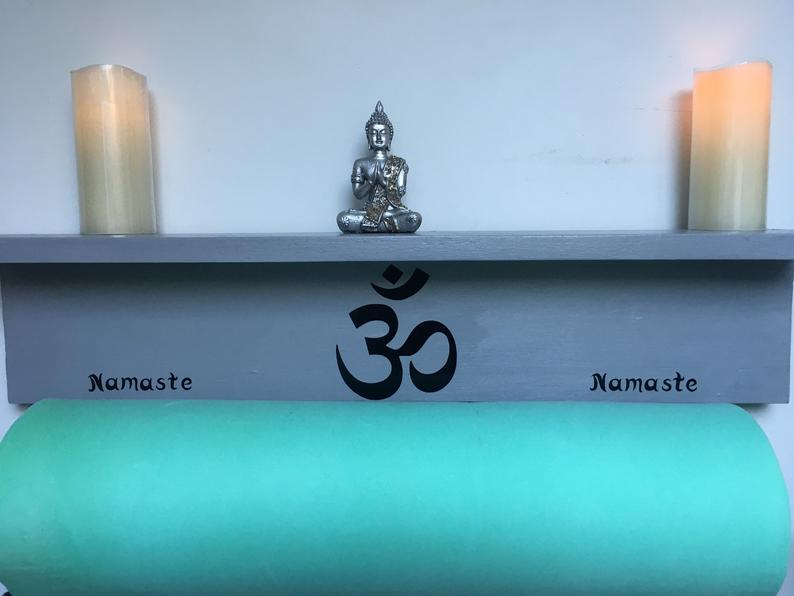 Yoga mat holder with shelf in reclaimed wood with Om sign, or lotus flower.