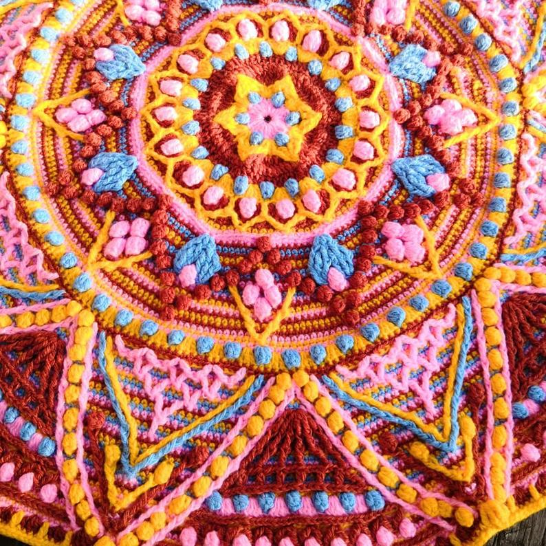 "Multicolor crochet mandala rug ""August"" with a diameter of 33 inches crocheted."